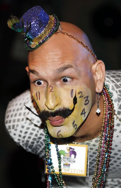 Keith Haubrich of Seattle, Wash., reacts to the crowd while competing in the Dali Moustache division during the fourth annual Just For Men National Beard and Moustache Championships Saturday, September 7, 2013 in New Orleans. Haubrich went on to win the gold medal for the Dali division.Contestants competed in 18 different categories including Dali, full beard natural and sideburns.(Photo by Susan Poag/AP Photo)