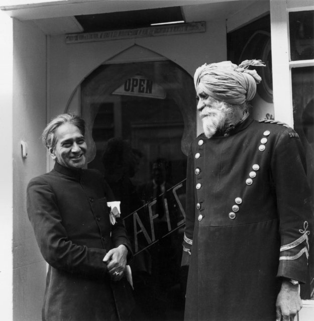 The doorman and proprietor outside and Indian Restaurant in an Indian Community in London, 1956. (Photo by Thurston Hopkins/Picture Post/Getty Images)