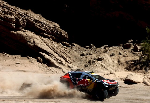 Stephane Peterhansel of France drives his Peugeot during the 11th stage of the Dakar Rally 2016 near San Juan, Argentina, January 14, 2016. (Photo by Marcos Brindicci/Reuters)