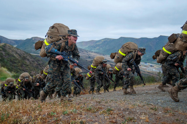 Recruits from U.S. Marine Corps Recruit Depot San Diego, Lima Company, participate in the final leg of the grueling Crucible training to become the first ever women Marines trained at Camp Pendleton, California, U.S., April 22, 2021. (Photo by Mike Blake/Reuters)
