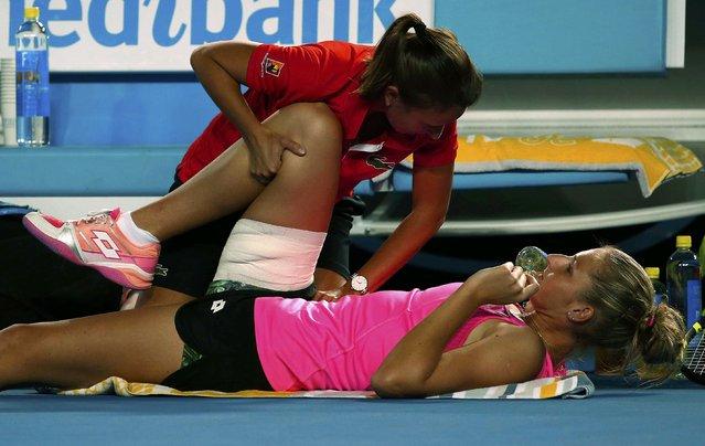 Czech Republic's Kristyna Pliskova receives treatment to her leg during her first round match against Australia's Samantha Stosur at the Australian Open tennis tournament at Melbourne Park, Australia, January 18, 2016. (Photo by Jason O'Brien/Reuters)