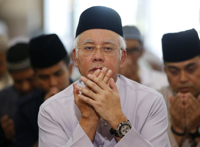 Malaysia's Prime Minister Najib Razak says special prayers for the victims of missing Malaysia Airlines Flight MH370 at the National Mosque in Kuala Lumpur January 30, 2015. Malaysia declared on Thursday the disappearance of Malaysia Airlines Flight MH370 an accident, clearing the way for the airline to pay compensation to victims' relatives while the search for the plane goes on. The Boeing 777 aircraft disappeared on March 8 last year, carrying 239 passengers and crew shortly after taking off from the Malaysian capital of Kuala Lumpur, bound for Beijing. REUTERS/Olivia Harris
