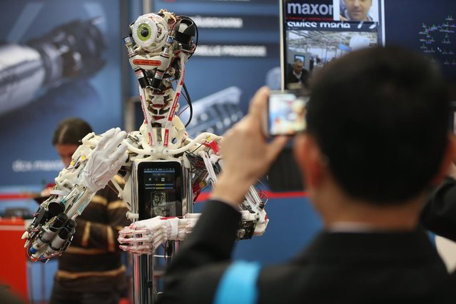 A robot stands on display at the Maxon Motor stand at the Hannover Messe 2013 industrial trade fair on April 8, 2013 in Hanover, Germany. (Photo by Sean Gallup/Getty Images)