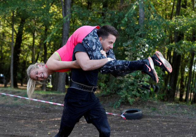 Participiants compete in Hungary's first wife-carrying championship in Tapiobicske, Hungary, October 3, 2020. (Photo by Bernadett Szabo/Reuters)