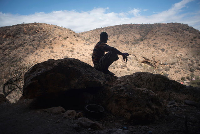Frankincense tapper Musse Ismail Hassan rests in a cave in a canyon near Gudmo, Somaliland, a breakaway region of Somalia on August 3, 2016. (Photo by Jason Patinkin/AP Photo)
