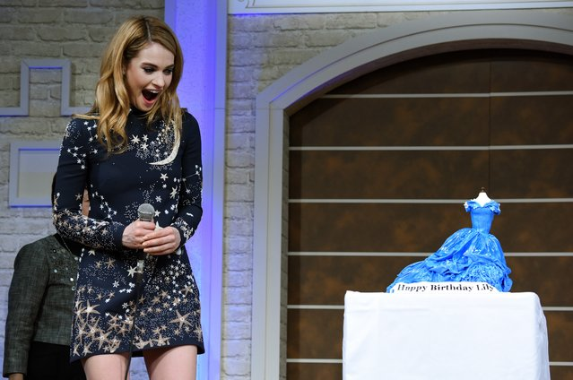 "British actree Lily James, who reached 26 years old on April 5, is surprised by a birthday cake in the shape of a Cinderella dress during a press conference to promote her latest movie ""Cinderella"" in Tokyo on April 7, 2015. The film will be shown all over Japan from April 25. (Photo by Toru Yamanaka/AFP Photo)"