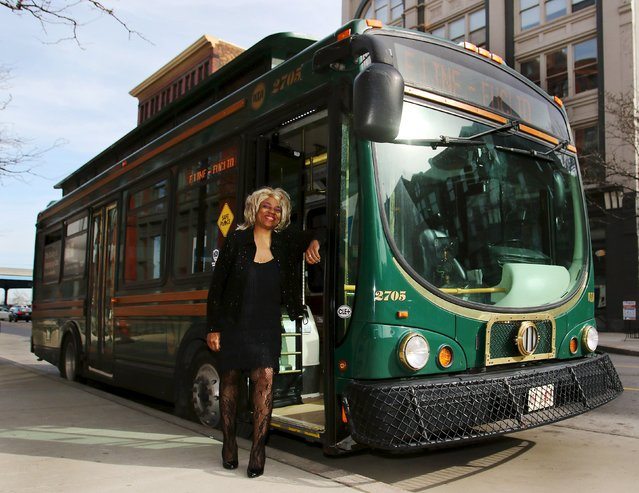 Crystal Hill, a Cleveland regional Transit Authority Trolley driver poses outside her trolley as Tina Turner as part of the Rock and Roll Hall of Fame Induction week in Cleveland, Ohio April 15, 2015. The city of Cleveland has kindly asked its downtown trolley-bus drivers to get in the spirit of this week's 2015 Rock and Roll Hall of Fame induction ceremony and dress up like a rock star, or simply a music great. Drivers can choose from the more than 700 inductees in the Hall of Fame, which holds its 30th ceremony on Saturday. (Photo by Aaron Josefczyk/Reuters)