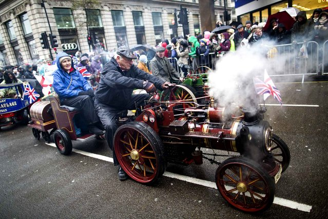 Steam and traction engine enthusiasts take part in the New Year's Day Parade in central London on January 1, 2014. (Photo by Justin Tallis/AFP Photo)