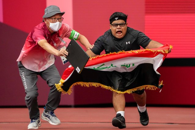 Iraq's Garrah Tnaiash reacts after a throw in the men's F40 shot put final during the 2020 Paralympics at the National Stadium in Tokyo, Sunday, August 29, 2021. (Photo by Eugene Hoshiko/AP Photo)