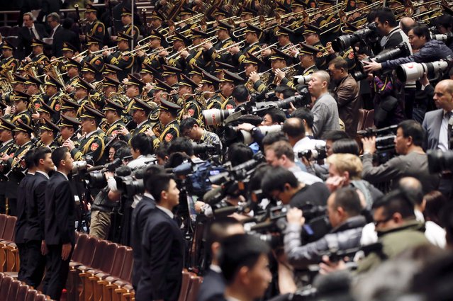 A military band plays China's national anthem as journalists take pictures and shoot video during the opening session of the National People's Congress (NPC) at the Great Hall of the People in Beijing, China, March 5, 2016. (Photo by Damir Sagolj/Reuters)