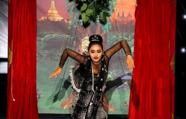 Miss Myanmar Htet Hten Htun performs a Burmese Puppetry after winning the national costume competition of the 65th Miss Universe beauty pageant at the Mall of Asia Arena, in Pasay, Metro Manila, Philippines January 30, 2017. (Photo by Erik De Castro/Reuters)