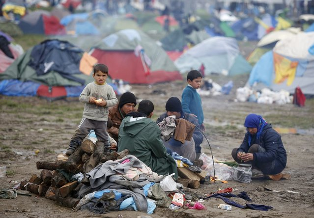 Migrant sit in a makeshift camp on the Greek-Macedonian border near the village of Idomeni, Greece March 10, 2016. (Photo by Stoyan Nenov/Reuters)