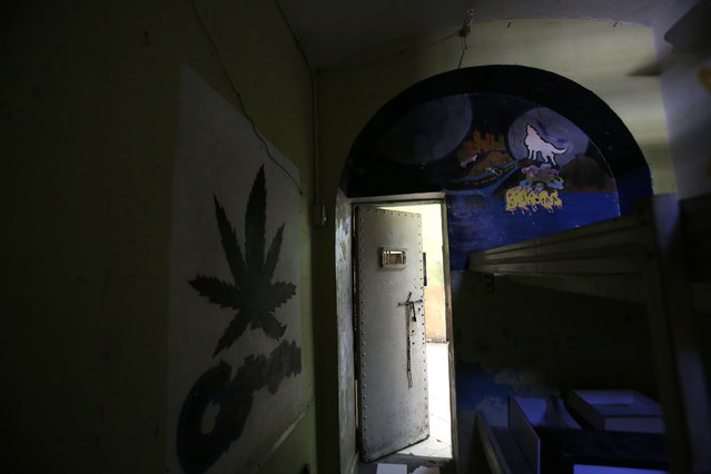 In this April 9, 2015 photo, murals decorate the walls of a cell inside the now empty Garcia Moreno Prison, during a guided tour for the public in Quito, Ecuador. According to tour guides, cell sizes vary, with the smallest being eight square meters (86 square feet), designed to hold two inmates but which actually held up to eight, and the largest cell being 30 square meters (322 square feet) which held as many as 40 people. However, prisoners with money could pay the gangs that controlled daily life inside to give them a cell with just one roommate. (Photo by Dolores Ochoa/AP Photo)