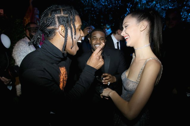 ASAP Rocky, ASAP Ferg, and Bella Hadid attend the Christian Dior Haute Couture Spring Summer 2017 Bal Masque as part of Paris Fashion Week on January 23, 2017 in Paris, France. (Photo by Victor Boyko/Getty Images for Dior)