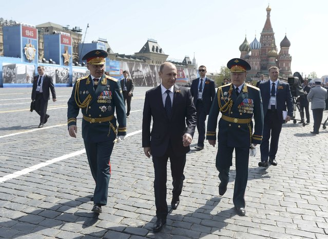 Russian President Vladimir Putin (C), Defence Minister Sergei Shoigu (L) and Colonel-General Oleg Salyukov, Victory Parade Commander, walk after the Victory Day parade at Red Square in Moscow, Russia, May 9, 2015. (Photo by Reuters/Host Photo Agency/RIA Novosti)