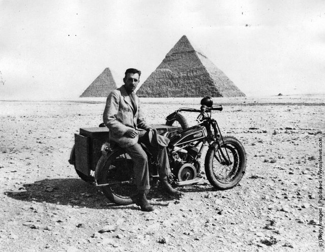 circa 1925: T. M. Moore, who crossed the Libyan desert on a motorbike, near the end of his journey, by the pyramids