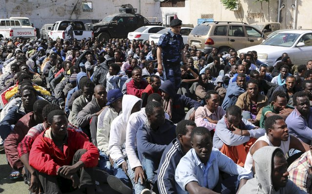 Migrants sit at a detention center after they were detained by the Libyan authorities in Tripoli, Libya May 17, 2015. (Photo by Hani Amara/Reuters)
