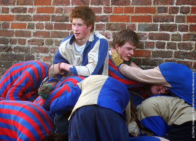 The youngest son of the Prince of Wales, Prince Harry and his brother Prince William (far right) take part in the Wall Game between Dr Gailey's Old Boys and the Mixed Wall in March, 2003 at Eton College, Eton