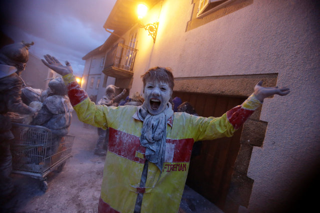 "A reveller participates in a flour fight during the ""O Entroido"" festival in Laza village, Spain February 27, 2017. (Photo by Miguel Vidal/Reuters)"