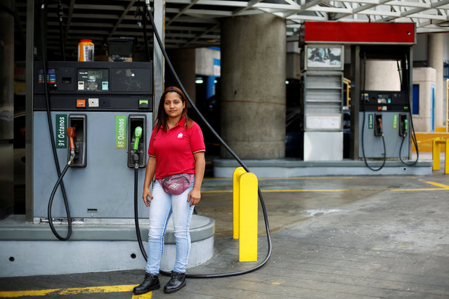 """Yanis Reina, 30, a gas station attendant, poses for a photograph at a gas station in Caracas, Venezuela February 24, 2017. """"No doubt this is a job initially intended for men, because you have to be standing on the street all your shift, it is dirty, greasy and there is always a strong gasoline smell. I have to adapt the pants of my uniform because they are men's and make me look weird but I adore my work. My clients are like my relatives, they come here everyday and we chat a couple of minutes while the tank is being filled. They come every day because they feel safer to be served by a woman"""", Reina said. """"With the difficult situation that we have in Venezuela, having a job that covers your expenses is almost a luxury, but beyond that, I'm very proud of my job. I believe that now we, the women, have to be the warriors"""", Reina said. (Photo by Carlos Garcia Rawlins/Reuters)"""