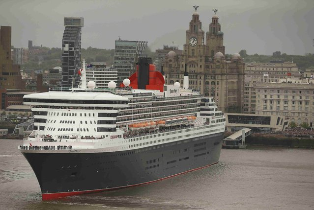The Cunard liner Queen Mary 2 performs a turn in front of the Liver buildings on the River Mersey in Liverpool, Britain May 25, 2015. (Photo by Phil Noble/Reuters)