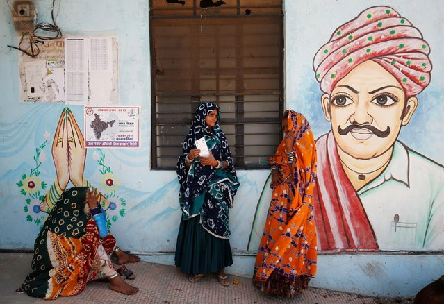 Women wait for a public transport outside a polling station after casting their votes at Sirohi district in the desert Indian state of Rajasthan, India April 29, 2019. (Photo by Amit Dave/Reuters)