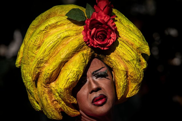 A reveller attends the annual LGBTQ pride parade in Madrid, Spain, Saturday, July 6, 2019. European cities celebrated LGBTQ pride on Saturday with colorful parades that also became platforms for political demands and a push back against far-right populist parties. This year's events in London, Madrid or Budapest mark the 50th anniversary of the Stonewall Inn uprising in New York against police persecution, a turning point in the modern gay rights movement. (Photo by Bernat Armangue/AP Photo)