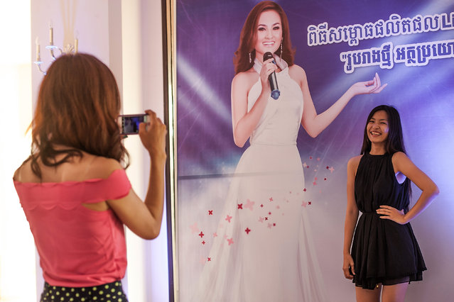 A professional model from the Sun Model Agency poses for a photo in the Sofitel Hotel corridors  on March 30, 2014 in Phnom Penh, Cambodia. (Photo by Omar Havana/Getty Images)