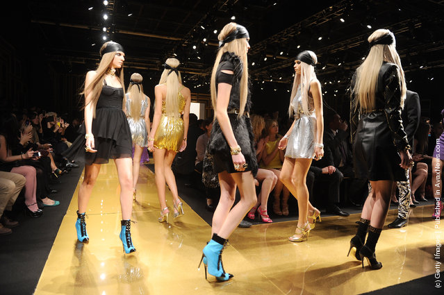 Models walk the runway at the Versace for H&M Fashion event at the H&M on the Hudson