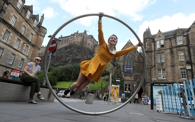 "Aerial and contemporary circus performer Bev Grant from the Edinburgh Festival fringe show ""Heroes"" performs a preview of her show on July 26, 2019, which is running at the festival from 1st–26th August at the Udderbelly in George Square, Edinburgh, Scotland. (Photo by Andrew Milligan/PA Wire Press Association)"