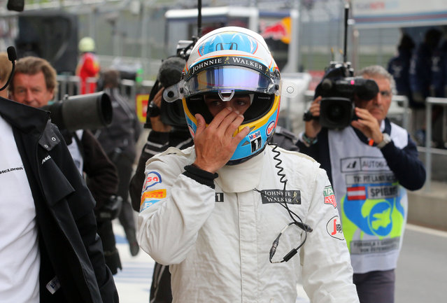 McLaren driver Fernando Alonso of Spain walks back to the pit during the third training session prior to the Formula One Grand Prix, at the Red Bull Ring in Spielberg, southern Austria, Saturday, June 20, 2015. (AP Photo/Ronald Zak)