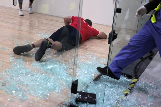 Mexico's Alvaro Beltran lies down after breaking a glass panel of the racquetball court during his Gold Medal Match against Mexico's Rodrigo Montoya during the Pan Am Games in Lima, Peru on August 7, 2019. (Photo by Guadalupe Pardo/Reuters)