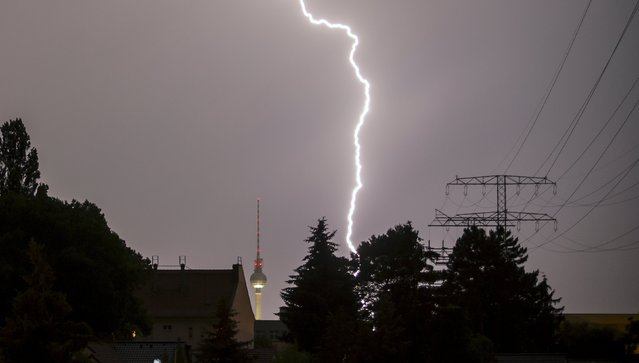 A lightning bolt strikes beside the television tower in Berlin, Germany, July 5, 2015. (Photo by Hannibal Hanschke/Reuters)