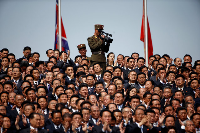 A soldier films North Korean soldiers, officers and high ranking officials  attending a military parade marking the 105th birth anniversary of the country's founding father Kim Il Sung in Pyongyang, North Korea, April 15, 2017. (Photo by Damir Sagolj/Reuters)