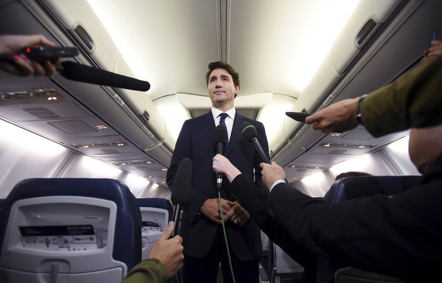 """Canadian Prime Minister and Liberal Party leader Justin Trudeau makes a statement in regards to a photo coming to light of himself from 2001, wearing """"brownface"""", during a scrum on his campaign plane in Halifax, Nova Scotia, Wednesday, September 18, 2019. (Photo by Sean Kilpatrick/The Canadian Press via AP Photo)"""