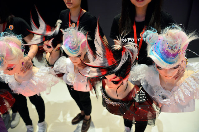 Hairdresser from Taiwan pose with their dolls at the OMC Hairworld World Cup on May 4, 2014 in Frankfurt am Main, Germany. The OMC Hairworld World Cup will be held in Frankfurt from 3 to 5 May 2014, parallel to the Hair and Beauty 2014 fair. (Photo by Thomas Lohnes/Getty Images)