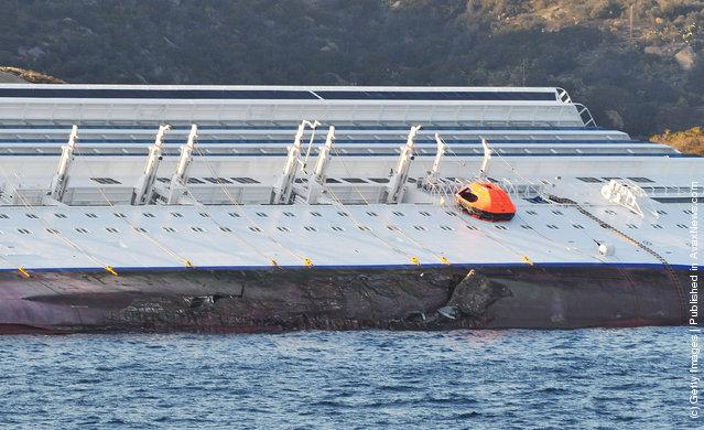 The cruise ship Costa Concordia lies stricken off the shore of the island of Giglio in Giglio Porto, Italy