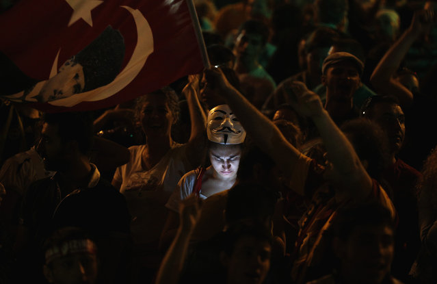 A protester uses her mobile phone during a demonstration at Taksim Square in Istanbul June 8, 2013. (Photo by Stoyan Nenov/Reuters)