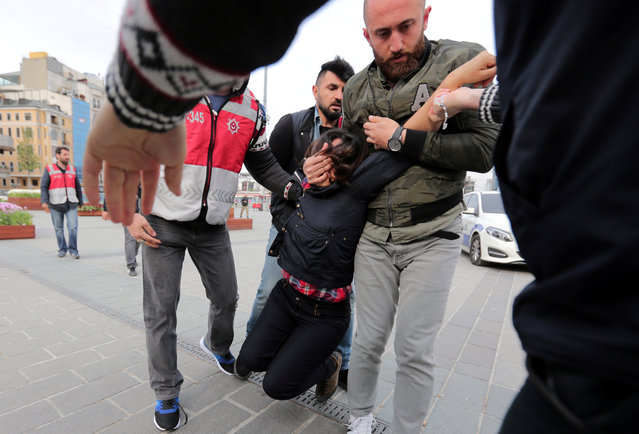 Plainclothes police officers detain a protester as she and others attempt to defy a ban and to gather at Taksim Square to celebrate May Day, in central Istanbul, Turkey on May 1, 2017. (Photo by Kemal Aslan/Reuters)