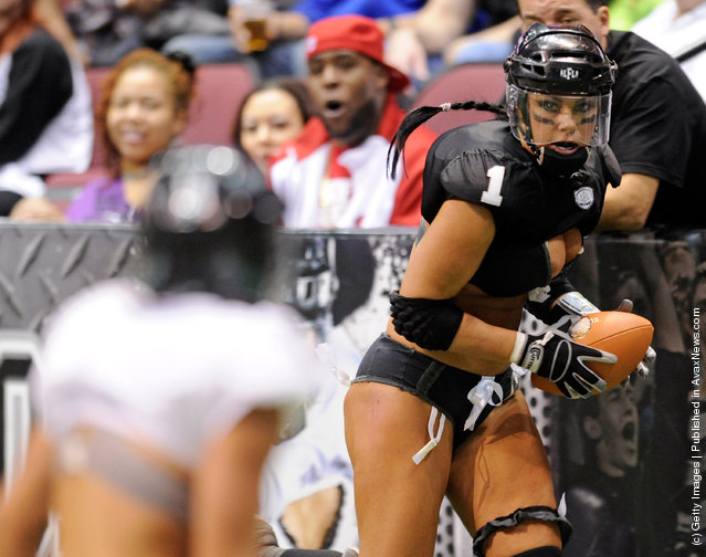 Audrey Latsko #1 of the Los Angeles Temptation runs for yardage against the Philadelphia Passion during the Lingerie Football League's Lingerie Bowl IX at the Orleans Arena