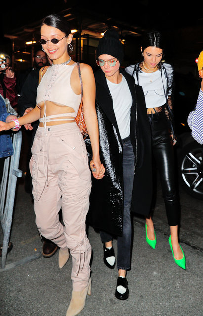 Kendall Jenner, Cara Delevingne, Bella Hadid arrive at Travis Scott concert on April 30, 2017 in New York City. (Photo by Gotham/GC Images)