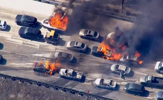 Cars are shown burning on the Interstate 15 freeway in the Cajon Pass, California in the frame grab from KNBC video July 17, 2015. A brush fire burning in foothills north of Los Angeles overran a freeway in a mountain pass on Friday, torching several cars and trucks as drivers scrambled to safety. (Photo by Reuters/NBCLA)