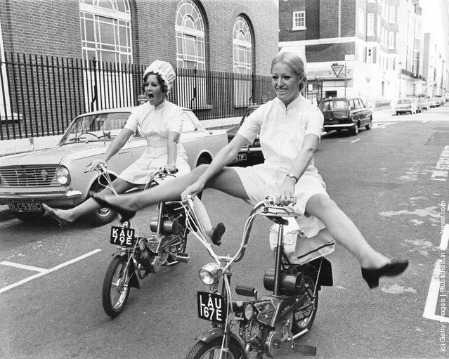 Models Glenda Warrington (left) and Caroline Whineray demonstrate the extra freedom and mobility afforded by the latest culotte dresses for nurses, 16th October 1967
