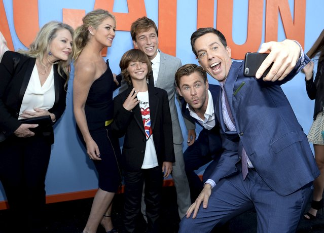 """Cast member Ed Helms (R) takes a selfie of fellow cast members Beverly D'Angelo (L-R), Christina Applegate, Steele Stebbins, Skyler Gisondo, and Chris Hemsworth during the premiere of the film """"Vacation"""" at the Regency Village Theatre in the Westwood section of Los Angeles, California July 27, 2015. (Photo by Kevork Djansezian/Reuters)"""