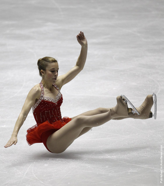 Ashley Wagner of the U.S. falls during her performance at the ladies' short programme at the World Team Trophy in Figure Skating in Tokyo April 19, 2012