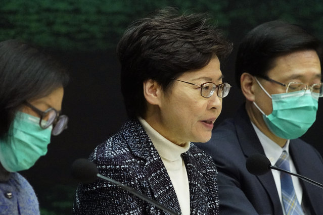 Hong Kong Chief Executive Carrie Lam, center, speaks during a press conference in Hong Kong Wednesday, February 5, 2020. In Hong Kong, hospitals workers are striking to demand the border with mainland China be shut completely to ward off the virus, but four new cases without known travel to the mainland indicate the illness is spreading locally in the territory. (Photo by Vincent Yu/AP Photo)