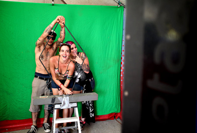 Fans have their picture taken in one of the promotion booths during the Vans Warped Tour at the Cruzan Amphitheatre in West Palm Beach on July 26, 2014.  (Photo by Richard Graulich/The Palm Beach Post)