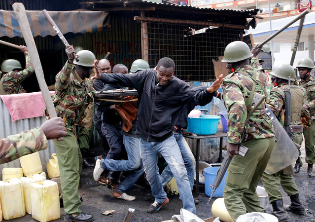 Anti riot policemen beat protesters to disperse them in Mathare, in Nairobi, Kenya August 9, 2017. (Photo by Thomas Mukoya/Reuters)