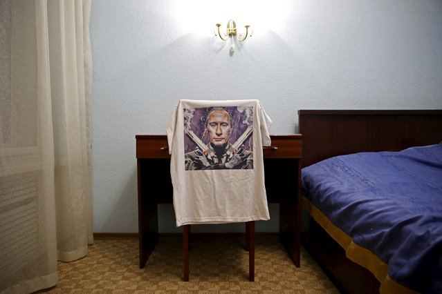 A t-shirt depicting Russian President Vladimir Putin is seen in this photo illustration taken in a hotel room in Kazan, Russia, August 5, 2015. (Photo by Stefan Wermuth/Reuters)