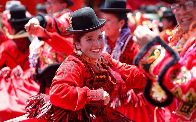 Women dressed as Cholas dance as carnival celebrations wind down in La Paz, Bolivia, Sunday, March 1, 2020. (Photo by Juan Karita/AP Photo)